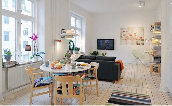 Quem possui uma sala grande, por exemplo, pode criar uma sala de jantar, de estar e de televisão. A divisão pode ser feita com móveis ou iluminação (Foto: Divulgação)
