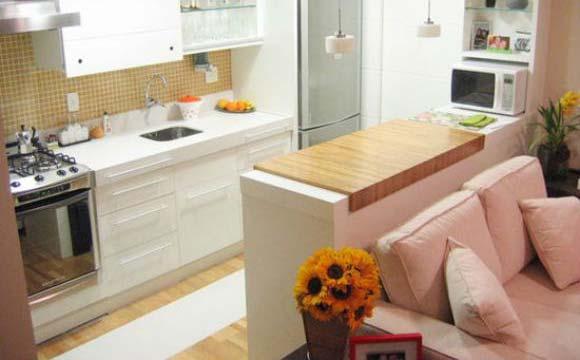 Bancada de madeira dá um visual diferente à cozinha, mas deve