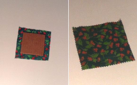 Pegue um tecido de patchwork de algodão, de Natal, e recorte duas faces (12 cm X 12 cm) com tesoura de picote. Recorte um papelão (8 cm X 8 cm), coloque entre as duas faces e cole com cola bastão. Faça o mesmo processo por cinco vezes