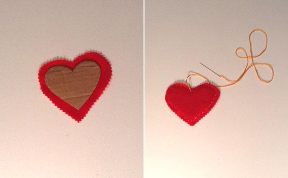 Recorte duas faces do feltro vermelho, em forma de coração, também com tesoura de picote. Recorte um papelão no mesmo formato e coloque no meio dos dois. Costure os tecidos com linha amarela. Faça o mesmo processo por quatro vezes