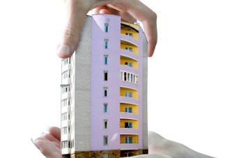 prédio na mão